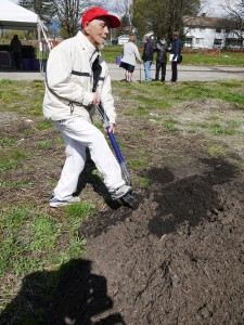 Sam Chang performs his own ground breaking ceremony at Little Mountain, April 11, 2013
